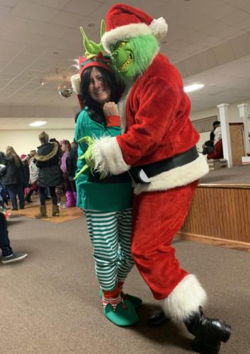 Santa's Bully Elf and the Grinch together for holiday magic!
