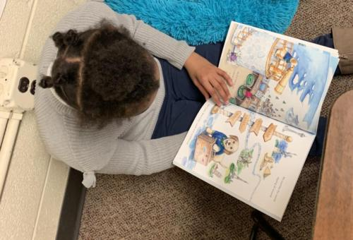 Restorative Practices include reading & bonding with another student!